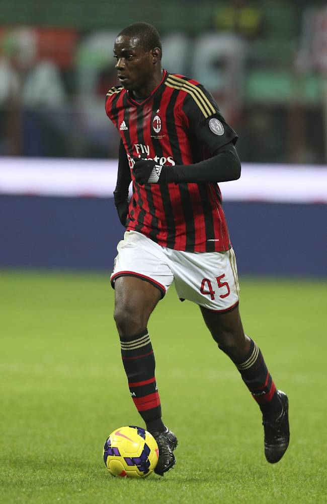 In this picture taken  Saturday, Nov. 23, 2013, AC Milan forward Mario Balotelli controls the ball during a Serie A soccer match between AC Milan and Genoa, at the San Siro stadium in Milan, Italy. Liverpool could be about to replace one controversial striker with another.  Italy international Mario Balotelli has been lined up by the Premier League club as a potential replacement for Luis Suarez, who left Anfield to join Barcelona for $130 million. Balotelli, who spent 2 years with Manchester City up to 2013, left the club's Milanello training ground on Thursday, Aug. 21, 2014, for possibly the last time.