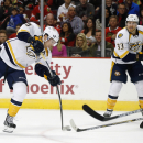 Nashville Predators left wing James Neal (18) shoots past Chicago Blackhawks defenseman Brent Seabrook (7) during the first period of an NHL hockey game on Saturday, Oct. 18, 2014, in Chicago The Associated Press
