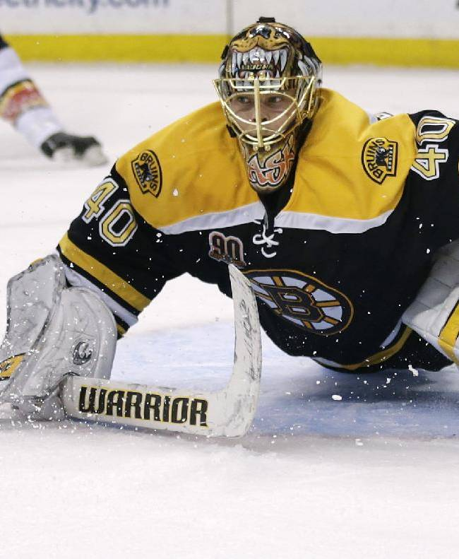 Boston Bruins goalie Tuukka Rask, of Finland, drops to the ice to make a save against the Florida Panthers during the first period of an NHL hockey game, Thursday, Nov. 7, 2013, in Boston