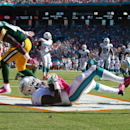 Miami Dolphins wide receiver Mike Wallace (11) catches a touchdown pass as Green Bay Packers strong safety Morgan Burnett (42) is late with the tackle during the second half of an NFL football game, Sunday, Oct. 12, 2014, in Miami Gardens, Fla The Associa