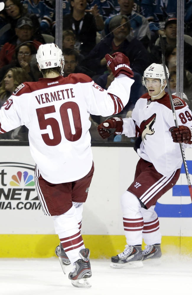 Phoenix Coyotes' Mikkel Boedker (89), of Denmark, celebrates his goal with teammate Antoine Vermette (50) during the second period of an NHL hockey game against the San Jose Sharks, Saturday, Nov. 2, 2013, in San Jose, Calif