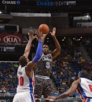 ORLANDO, FL - FEBRUARY 5: Victor Oladipo #5 of the Orlando Magic shoots the ball against the Detroit Pistons during the game on February 5, 2014 at Amway Center in Orlando, Florida. (Photo by Fernando Medina/NBAE via Getty Images)
