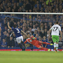 Everton's Leighton Baines, second left, scores a penalty past Wolfsburg's goalkeeper Diego Benaglio from Switzerland during their Europa League Group H soccer match at Goodison Park Stadium, Liverpool, England, Thursday Sept. 18, 2014