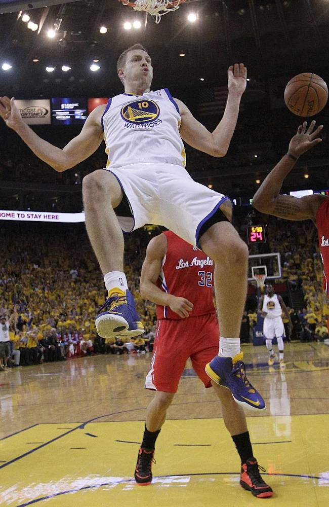 Golden State Warriors power forward David Lee (10) drops from the rim after dunking against the Los Angeles Clippers during the first half of Game 6 of an opening-round NBA basketball playoff series in Oakland, Calif., Thursday, May 1, 2014