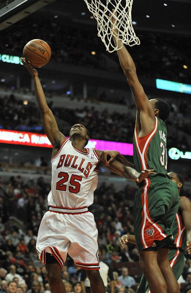 Chicago Bulls' Marquis Teague (25), goes up for a shot against MIlwaukee Bucks' John Henson (31), during the second half of an NBA preseason basketball game in Chicago, Monday, Oct. 21, 2013. Chicago won 105-84