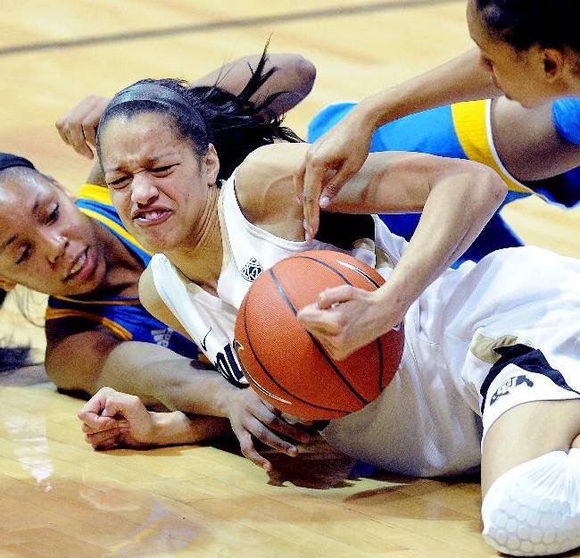 UCLA's Nirra Fields, left, and Colorado's Arielle Roberson scramble for a loose ball during the second half of an NCAA college basketball game Friday, Feb. 28, 2014, in Boulder, Colo. Colorado won 62-42