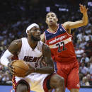 Washington Wizards' Otto Porter (22) forces Miami Heat's LeBron James (6) to pass the ball during the first half of an NBA basketball game, Monday, March 10, 2014, in Miami. (AP Photo/J Pat Carter)