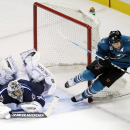 San Jose Sharks center Joe Pavelski, right, collides with Winnipeg Jets goalie Ondrej Pavelec, of the Czech Republic, during the first period of an NHL hockey game Saturday, Oct. 11, 2014, in San Jose, Calif The Associated Press