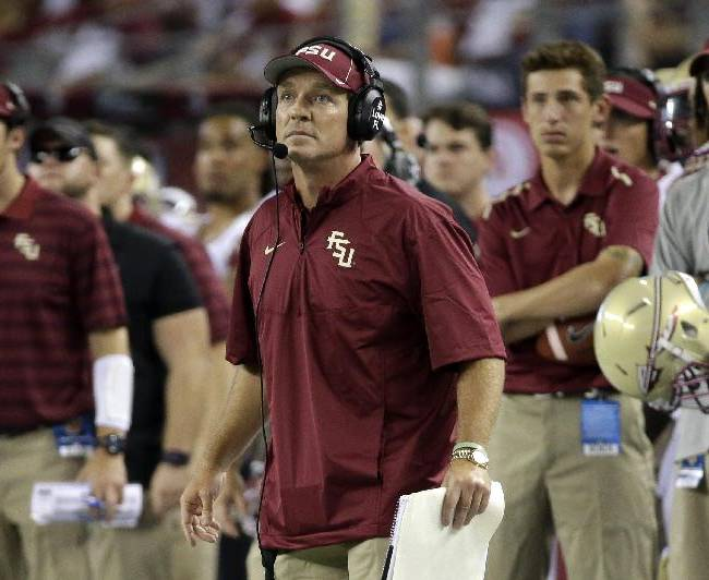 Florida State coach Jimbo Fisher watches an extra point by his team against Oklahoma State in the second half of an NCAA college football game, Saturday, Aug. 30, 2014, in Arlington, Texas