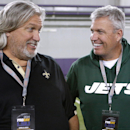 New Orleans Saints defensive coordinator Rob Ryan, left, and New York Jets head coach Rex Ryan talk to each other during NFL football pro day, Wednesday, April 9, 2014, in Baton Rouge, La The Associated Press