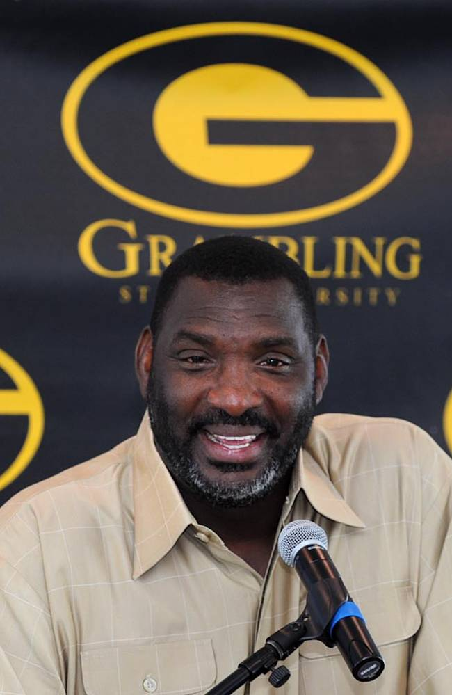 In this Aug. 12, 2012, file photo, Grambling State head coach Doug Williams talk with reporters during a news conference about the Port City Classic NCAA college football game in Shreveport, La.  Grambling State announced Wednesday, Sept. 11, 2013, that they fired Williams, and bought out the remainder of his contract after the team lost its first two games of the season