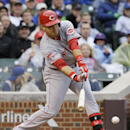 Suarez single in 10th lifts Reds over Cubs 5-4 The Associated Press