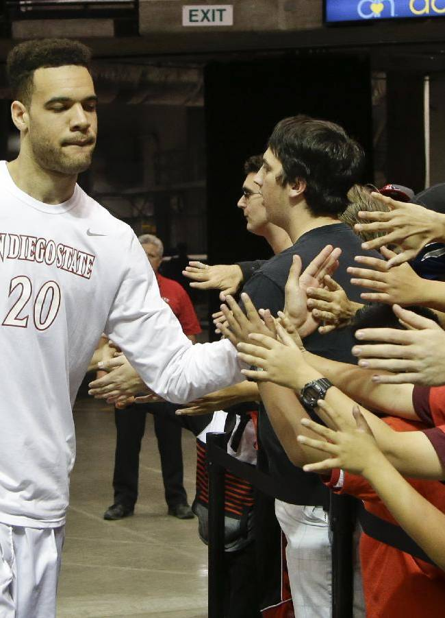 San Diego State forward JJ O'Brien slaps hands with the San Diego State students after a 118-35 victory over St. Katherine College in a NCAA college basketball game on Friday, Dec. 27, 2013, in San Diego