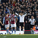 Fulham's Dimitar Berbatov, center, celebrates his penalty goal against Aston Villa during their English Premier League soccer match at Craven Cottage, London, Sunday, Dec. 8, 2013
