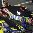 Cars for Kyle Busch (18) and Matt Kenseth (17) are covered during a rain delay at the NASCAR Sprint Cup Series auto race at Richmond International Raceway in Richmond, Va., Saturday, Sept. 8, 2012. (AP Photo/Jason Hirschfeld)