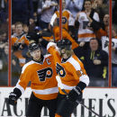 Philadelphia Flyers' Claude Giroux (28) and Jakub Voracek (93), of the Czech Republic, celebrate after Giroux's goal during the third period of an NHL hockey game against the Toronto Maple Leafs, Friday, March 28, 2014, in Philadelphia. Philadelphia won 4