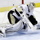 Pittsburgh Penguins goalie Jeff Zatkoff stops the puck during the third period of an NHL hockey game against the Florida Panthers, Saturday, Nov. 30, 2013, in Sunrise, Fla. The Penguins won 5-1 The Associated Press