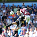 Hull City's Michael Dawson, left, battles for the ball with Aston Villa's Aly Cissokho during their English Premier League soccer match at Villa Park, Birmingham, England, Sunday, Aug. 31, 2014