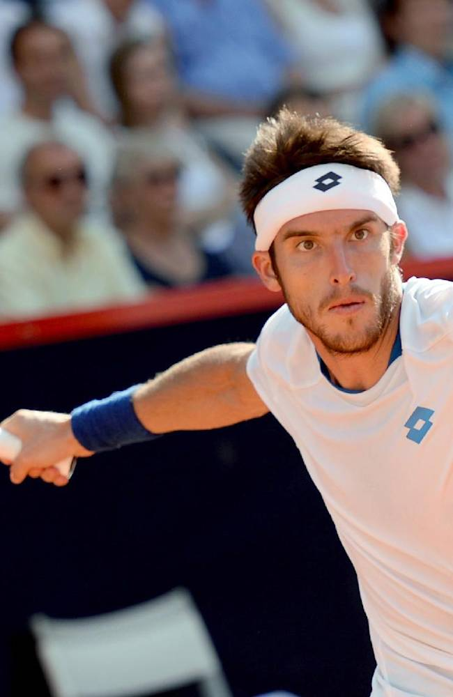 Leonardo Mayer of Argentina returns a shot to Germany's Philipp Kohlschreiber in their semi final match at the German Open tennis tournament in Hamburg, Germany, Saturday, July 19, 2014. Mayer won the match with 7-5 and 6-4