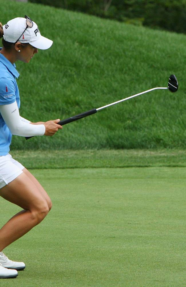 Azahara Munoz, of Spain, reacts as she misses her putt on the seventh hole during final-round play at the Canadian Pacific Women's Open golf tournament in London, Ontario, Sunday, Aug. 24, 2014