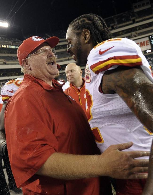 Kansas City Chiefs coach Andy Reid, left, and Dwayne Bowe celebrate in the final minutes of an NFL football game against the Philadelphia Eagles, Thursday, Sept. 19, 2013, in Philadelphia. Kansas City won 26-16