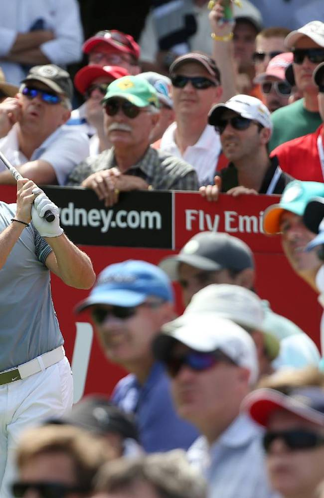 Northern Ireland's Rory McIlroy grimaces after his tee shot at the 14th hole during the second round of the Australian Open Golf championship in Sydney, Friday, Nov. 28, 2014