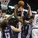 Boston Celtics' Kris Humphries, left, and Jeff Green (8) battle for a rebound with Memphis Grizzlies' Mike Miller (13), Ed Davis, center, and Kosta Koufos, second from right, in the first quarter of an NBA basketball game in Boston, Wednesday, Nov. 27, 20