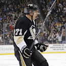 Pittsburgh Penguins' Evgeni Malkin (71) celebrates his goal in the second period of an NHL hockey game against the New York Islanders in Pittsburgh, Saturday, Oct. 18, 2014 The Associated Press
