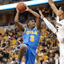 UCLA's Jordan Adams, left, tries to shoot over Missouri's Jordan Clarkson, right, during the second half of an NCAA college basketball game Saturday, Dec. 7, 2013, in Columbia, Mo. Missouri won the game 80-71. Adams scored a team-high 22 points The Assoc