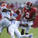 Alabama wide receiver DeAndrew White (2) fumbles the ball against Florida linebacker Neiron Ball (11) during the first half of an NCAA college football game on Saturday, Sept. 20, 2014, in Tuscaloosa, Ala. (AP Photo/Butch Dill)
