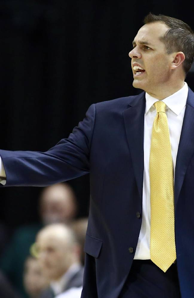 Indiana Pacers coach Frank Vogel yells to his players in the first half of an NBA basketball game against the Orlando Magic in Indianapolis, Tuesday, Oct. 29, 2013. The Pacers won 97-87