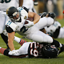 Jacksonville Jaguars running back Toby Gerhart (21) is tackled by Chicago Bears safety Danny McCray (29) during the first half of an NFL preseason football game in Chicago, Thursday, Aug. 14, 2014 The Associated Press