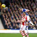 Everton s Leon Osman (right) and Stoke City s Charlie Adam battle for the ball in the air during the English Premier League match at Goodison Park, Liverpool Saturday Nov. 30, 2013