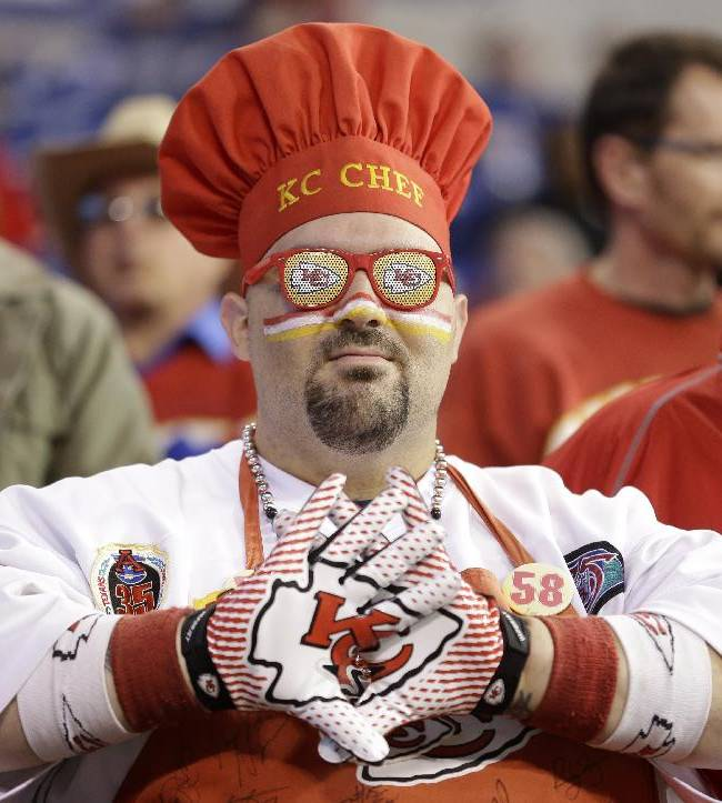 A Kansas City Chiefs fans watches during warm-ups before an NFL wild-card playoff football game against the Indianapolis Colts Saturday, Jan. 4, 2014, in Indianapolis