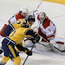 Nashville Predators center Mike Fisher, center, scores a goal past Carolina Hurricanes goalie Cam Ward (30) tying the game in the third period of an NHL hockey game Tuesday, Jan. 6, 2015, in Nashville, Tenn The Associated Press