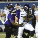 Wisconsin-Whitewater running back Jordan Ratliffe (27) gains yards against Mount Union's Tre Jones (5) and Mason Minnich (6) during the first half of the NCAA Division III championship college football game in Salem, Va., Friday Dec. 19, 2014. (AP Photo/Don Petersen)