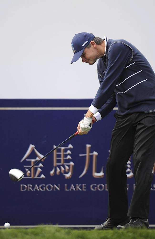 Paul Lawrie of Scotland tees off the 1st hole during the Foursomes Match between Asian team's Thongchai Jaidee and Kiradech Aphibarnrat of Thailand and European team's Stephen Gallacher and Lawrie of Scotland at the 7th Edition of the Royal Trophy-Europe vs. Asia Golf Championship at Dragon Lake Golf Club in Guangzhou, in south China's Guangdong province, Friday, Dec. 20, 2013