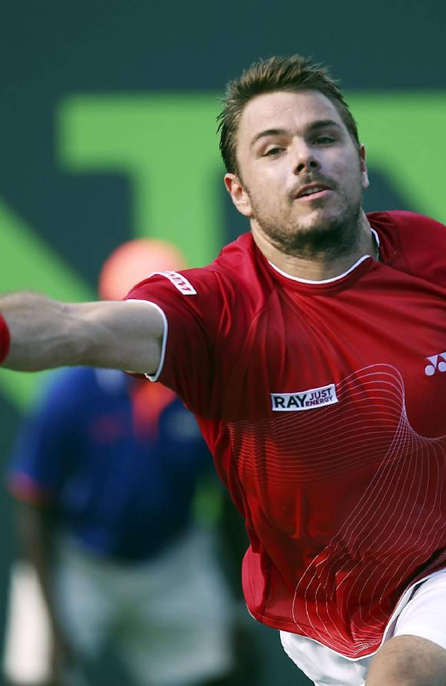 Stanislas Wawrinka, of Switzerland, returns the ball to Edouard Roger-Vasselin, of France, during the Sony Open Tennis in Key Biscayne, Fla., Monday, March 24, 2014