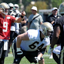 New Orleans Saints quarterback Drew Brees (9) directs the offensive line on a play during an NFL football training camp in White Sulphur Springs, W. Va., Saturday, July 26, 2014 The Associated Press