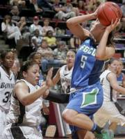 Florida Gulf Coast's Sarah Hansen (5) is fouled by St. Bonaventure's Doris Ortega (4) as she goes for a layup in the first half of an NCAA tournament first-round women's college basketball game on Sunday, March 18, 2012, in Tallahassee, Fla. (AP Photo/Phil Sears)