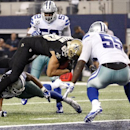 New Orleans Saints' Jimmy Graham (80) leaps over Dallas Cowboys strong safety J.J. Wilcox, bottom, into the end zone for a touchdown as middle linebacker Rolando McClain (55) and outside linebacker Justin Durant (52) watch during the second half of an NFL