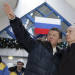 FILE - In this Wednesday, Jan, 2, 2008 file photo Russian President Vladimir Putin, right, listens to the state-controlled natural gas monopoly Gazprom CEO Alexei Miller as they tour the newly opened alpine ski center that will be used in the 2014 Olympics at Krasnaya Polyana in the southern Russian Black Sea resort of Sochi. The names of Russias business powerhouses have taken over the mountains of Sochi, now the home of Potanins slope, Gazproms gondola lift and Sberbanks ski jump. These names, used by local residents and an army of construction workers, leave no doubt about who is paying for next years Winter Games. (AP Photo/ RIA Novosti, Dmitry Astakhov, Presidential Press Service, File)