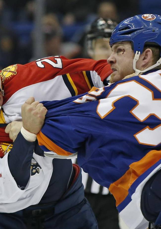 New York Islanders left wing Eric Boulton (36) fights with Florida Panthers right wing Krys Barch (21) during the first period of an NHL hockey game at Nassau Coliseum in Uniondale, N.Y., Sunday, March 2, 2014