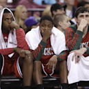 Milwaukee Bucks' Khris Middleton, left, Brandon Knight, Center, and Ersan Ilyasova, of Turkey, watch the closing moments of the Bucks 124-107 loss to the Sacramento Kings in a NBA basketball game in Sacramento, Calif., Sunday, March 23, 2014 The Associate