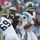 In this Sept. 16, 2012 file photo, Carolina Panthers' Jordan Gross (69) keeps New Orleans Saints' Will Smith (91) blocked as panther quarterback Cam Newton (1) looks for a receiver during the first half of an NFL game in Charlotte, N.C. Playing offensiv