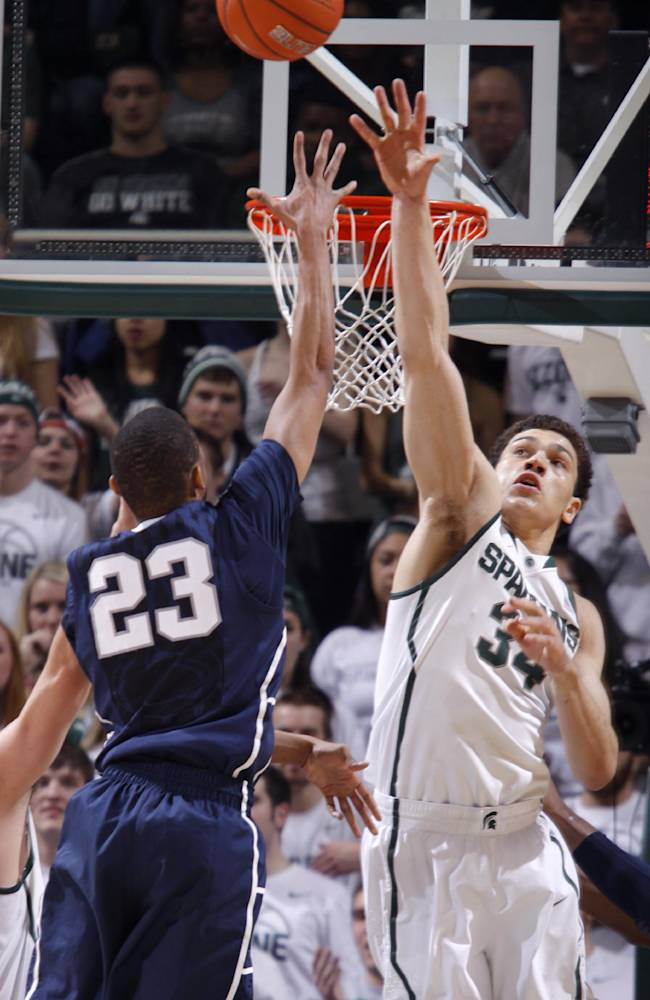 Michigan State's Gavin Schilling, right, defends on a shot by Penn State's Tim Frazier (23) during the second half of an NCAA college basketball game, Thursday, Feb. 6, 2014, in East Lansing, Mich. Michigan State won 82-67