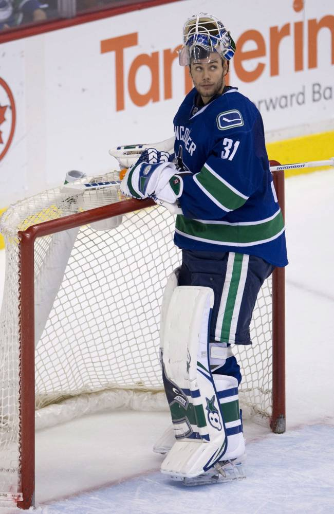 Vancouver Canucks goalie Eddie Lack (31) reacts to Anaheim Ducks right wing Kyle Palmieri's goal during the second period of NHL action in Vancouver on Monday, April 7, 2014