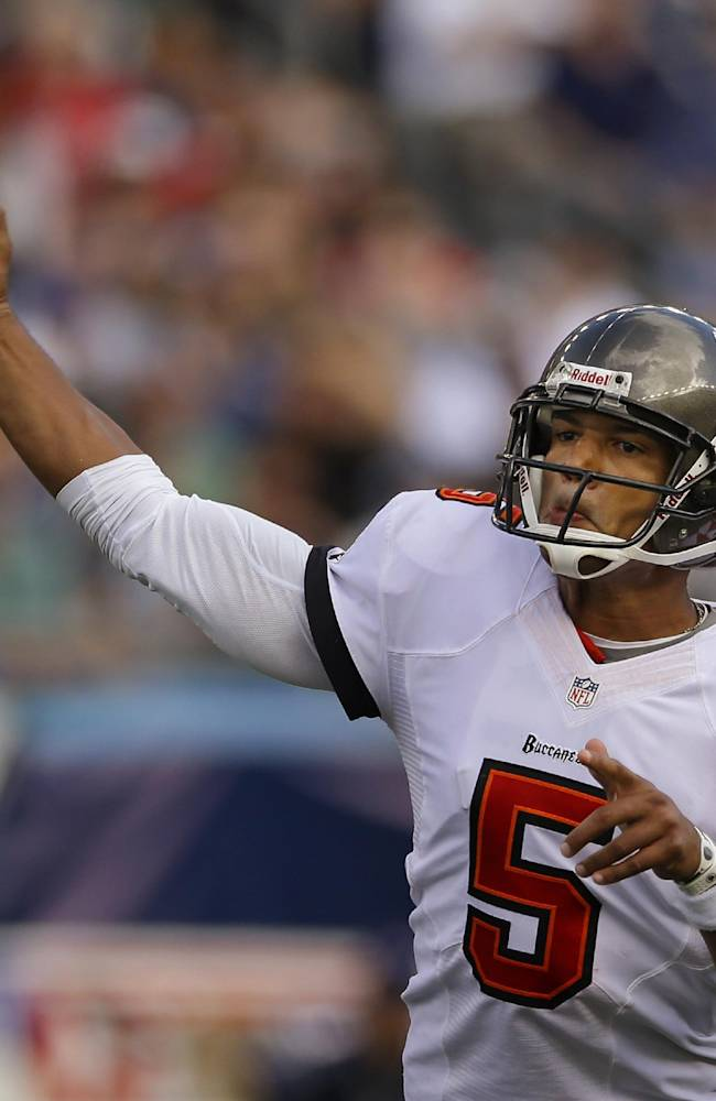 Tampa Bay Buccaneers quarterback Josh Freeman (5) throws a pass in the second half of an NFL football game against the New England Patriots Sunday, Sept. 22, 2013, in Foxborough, Mass