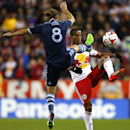 New York Red Bulls defender Roy Miller (7) battles Sporting Kansas City midfielder Graham Zusi (8) for the ball in the first half during an MLS playoff soccer match at Red Bull Arena in Harrison, N.J., Thursday, Oct. 30, 2014. The Red Bulls defeated Kansa