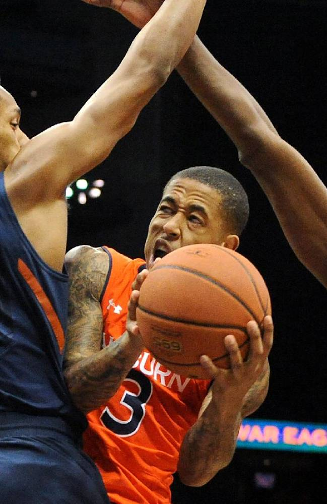 Auburn guard Chris Denson (3) is fouled by Illinois guard Joseph Bertrand (2) while Illinois' Nnanna Egwu (32) tries to block the shot in the first half of an NCAA college basketball game on Sunday, Dec. 8, 2013, in Atlanta